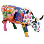 kolorowa krowa z głową w dół